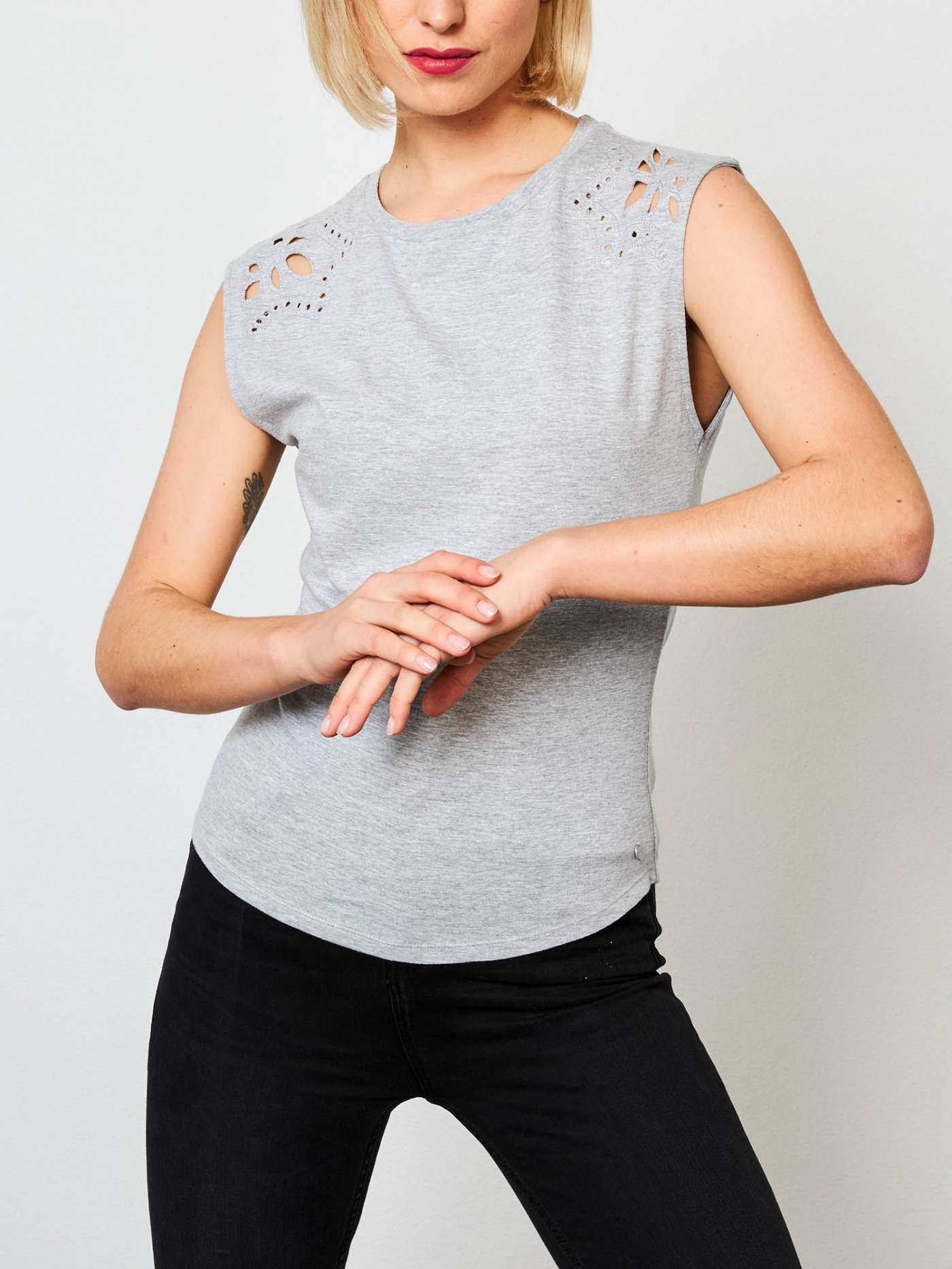 Tank top with cut-outs.