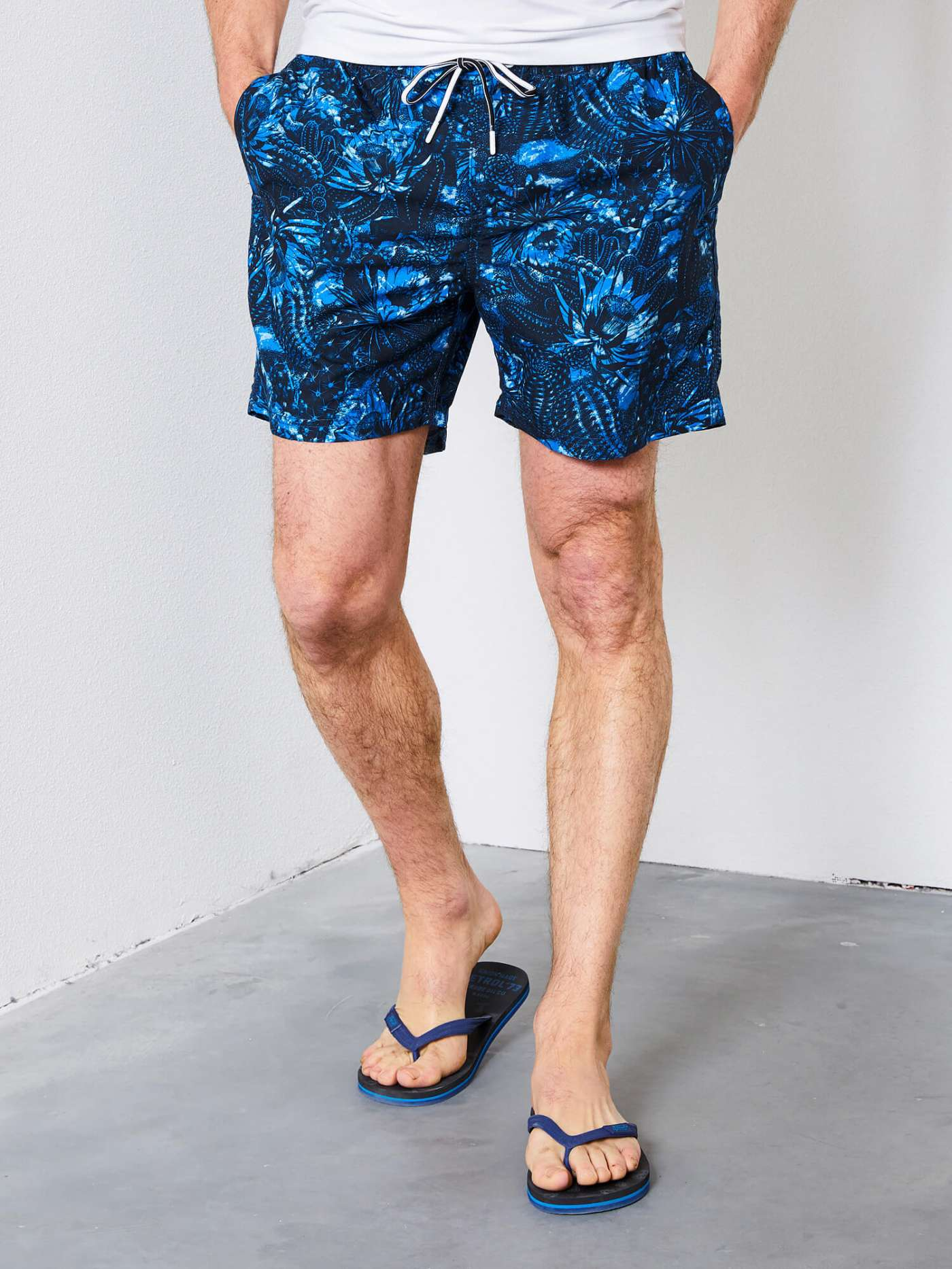 Swimming trunks with coloured print